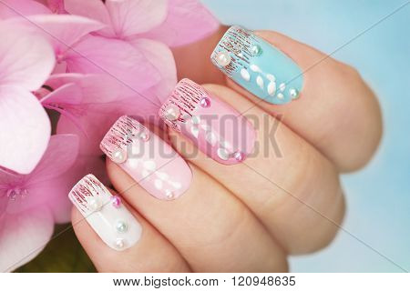 Colored manicure with hydrangea.