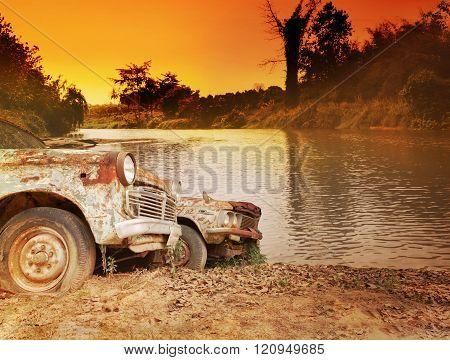 Old Antique Vehicle Car Parkat Riverside In Twilight