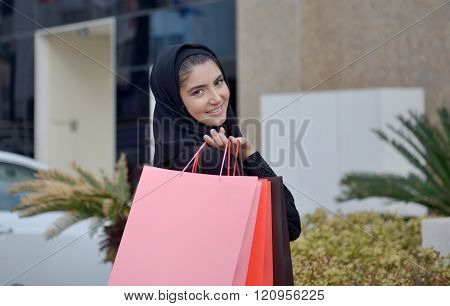 Emarati Arab Woman Coming Out Of Shopping
