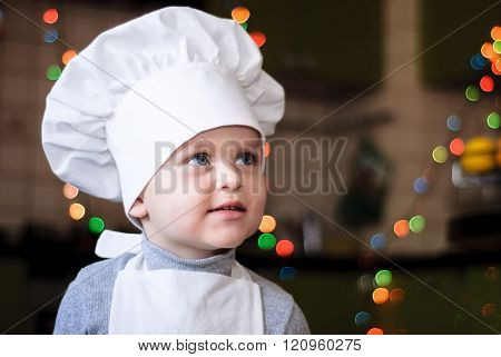 Portrait Of A Girl In A Cap And Apron Chef