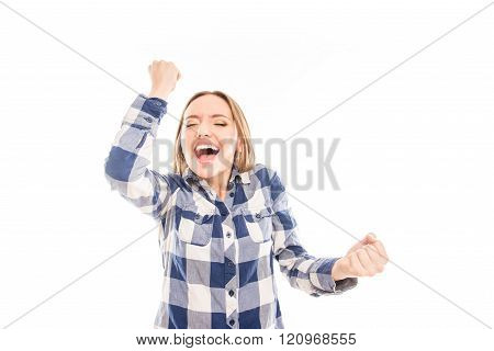 Happy Girl Celebrating Her Victory With Raised Hands And Screaming