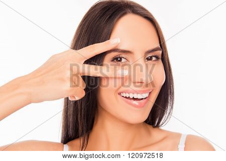 Cheerful Healthy Woman Gesturing With Two Fingers Near Her Eyes