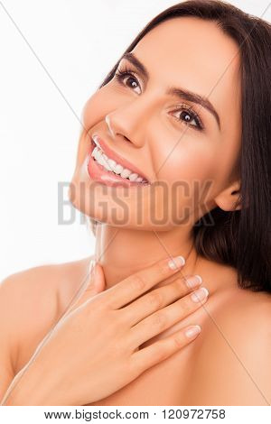 Close Up Portrait Of Beautiful Young Woman With Big Brown Eyes Touching Her Neck