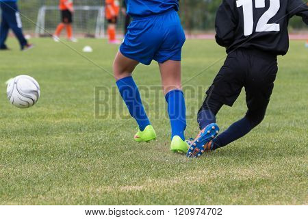 PARMA, ITALY -MARCH 2015:  Little Soccer Players during Match Goalkeeper Defender and White Ball