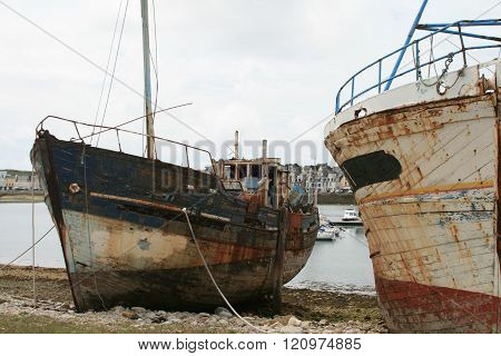 Old And Rusty Desolate Fishing Ships In Shipyard