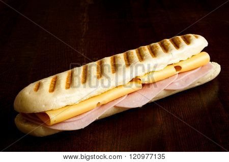 Cheese And Ham Toasted Panini. Isolated On Wood.