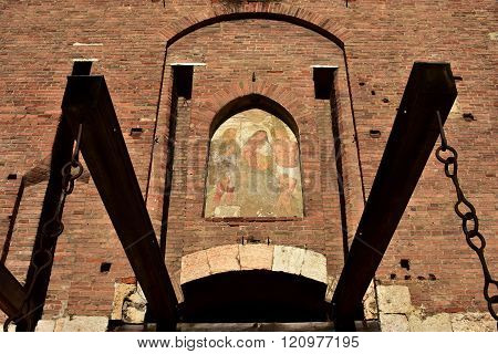 Fresco With Virgin Mary Among Saints Over Castel Main Gate, In Verona