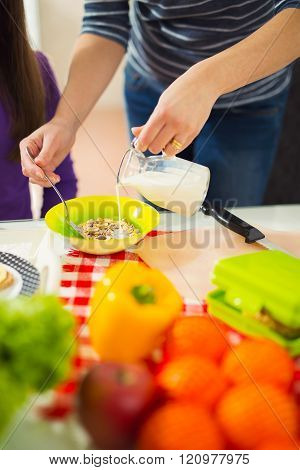 Mother preparing healthy meals for child at home