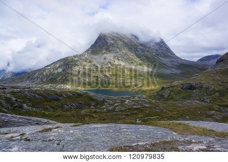 mountain is covered with clouds, mountain landscape in norway