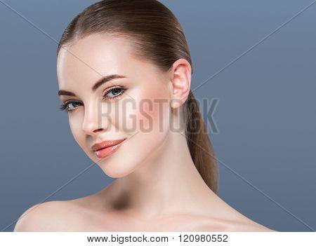 Woman Beauty Portrait Skin Care Concept On Blue Background.