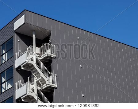 Metal Fire Escape Outside Apartment Building For Emergency.