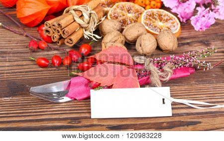 a cutlery and cards before autumnal decoration
