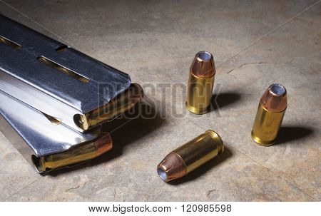 Cartridges with hollow point bullets and magazines for semi auto pistol