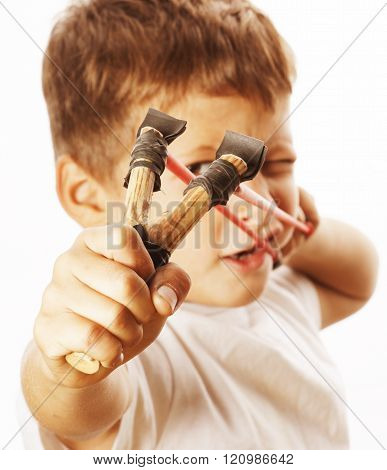 little cute angry real boy with slingshot isolated