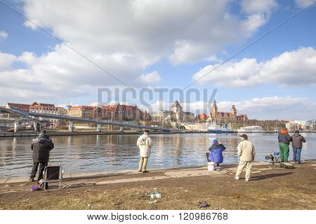 Men Fishing In The Odra River.
