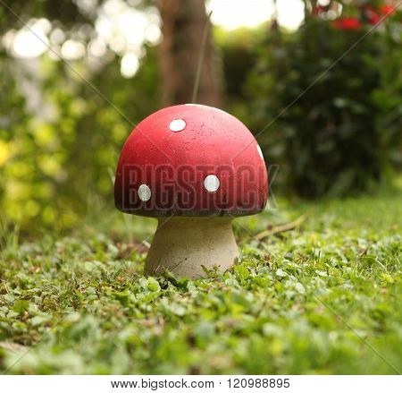 a fly agaric from clay stands on a meadow