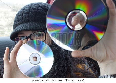 Girl With Two Compact Discs