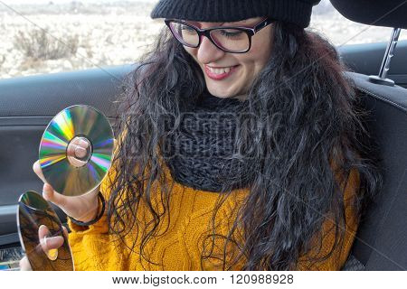 Girl Very Happy In A Car With Two Cds
