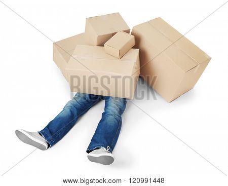 Man lying under pile of carton boxes isolated on white background