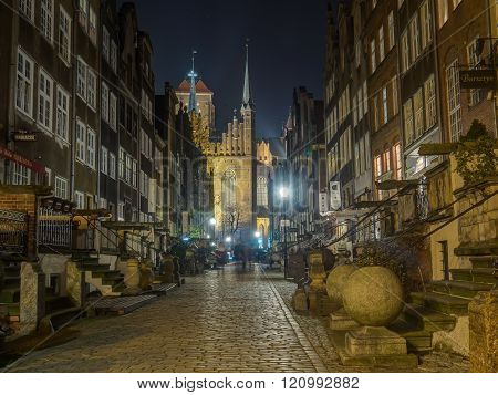 Gdansk Poland - September 27 2015: A paved street of Gdansk at night illuminated by street lamps