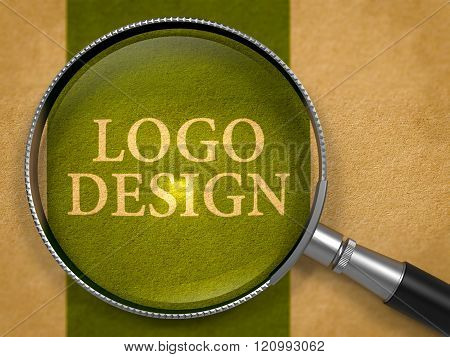 Logo Design through Loupe on Old Paper.