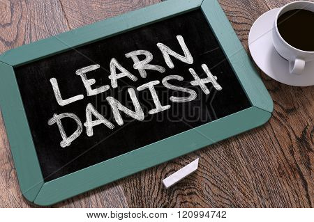 Learn Danish Concept Hand Drawn on Chalkboard.