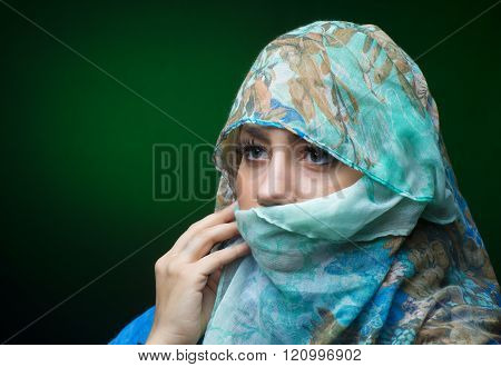 Portait Of Woman Wearing A Blue Scarf