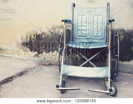the Vintage Old Wheelchairs with wall background