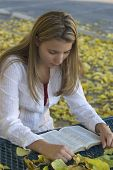image of girl reading book  - A young woman reading - JPG