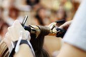 Постер, плакат: stylist hairdresser doing haircut