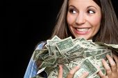 pic of greed  - Beautiful smiling woman holding money - JPG
