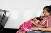 stock photo of native american ethnicity  - Young girl sleeping on mother - JPG