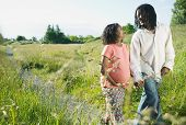 picture of pregnant woman  - Pregnant woman and a man walking in a park - JPG