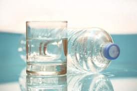 image of bottle water  - a glass of fresh water and a bottle - JPG