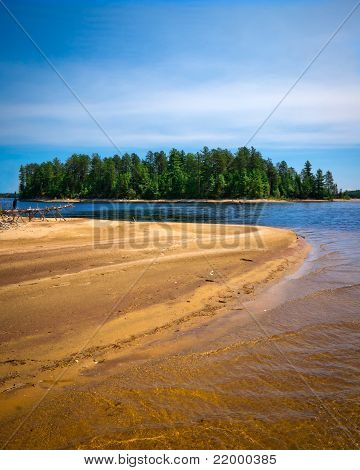 Sandy Beach With Treed Island In Background