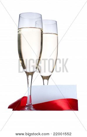 Glasses with Champagne and blank invitation card