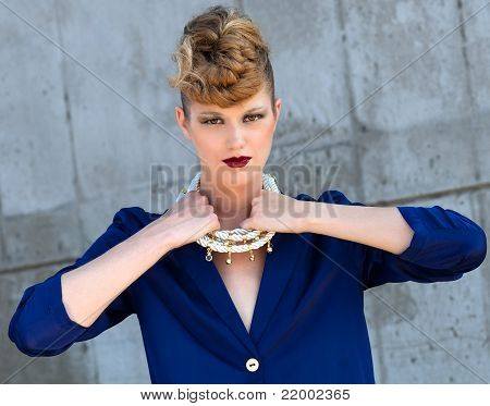 Beauty shot with blond model holding neckless