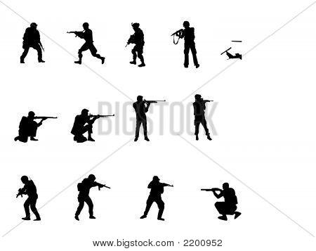 Silhuetas de homens armados