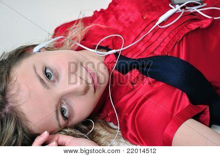 Teenage girl with music player