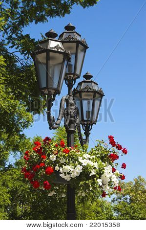 The Old Lighting Lanterns With Baskets Of Flowers