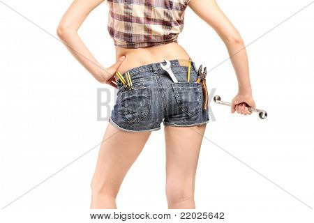 Female worker holding a wrench isolated on white background