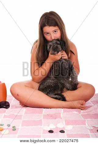 Girl In Swimsuit At The Beach Kissing Her Dog