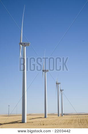 A Row Of Wind Turbines