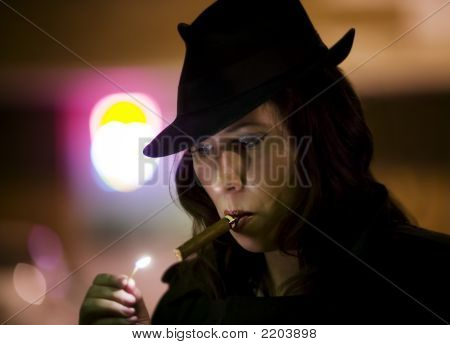 Woman Lighting Cigar