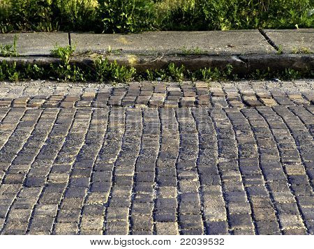 Cobblestones And Curb