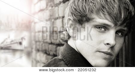 Sepia toned extreme close up portrait of a young man
