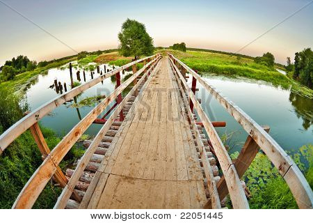 Wooden Bridge Over The Small River