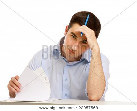 Tired handsome man working at the desk, isolated on white background