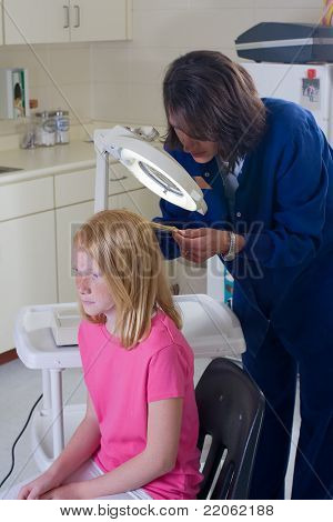 Nurse Checking For Head Lice