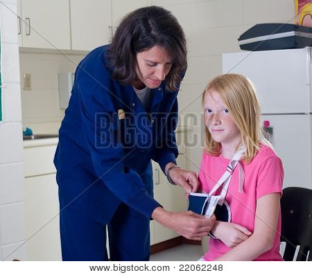 School Nurse And Student Patient
